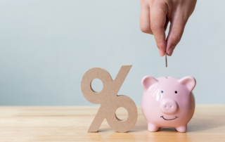 % sign, a piggy bank with coin insertion