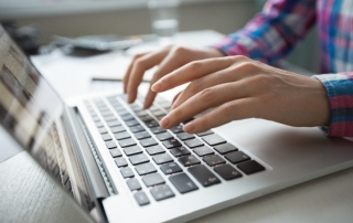 cropped-view-hands-typing-laptop_1262-3196